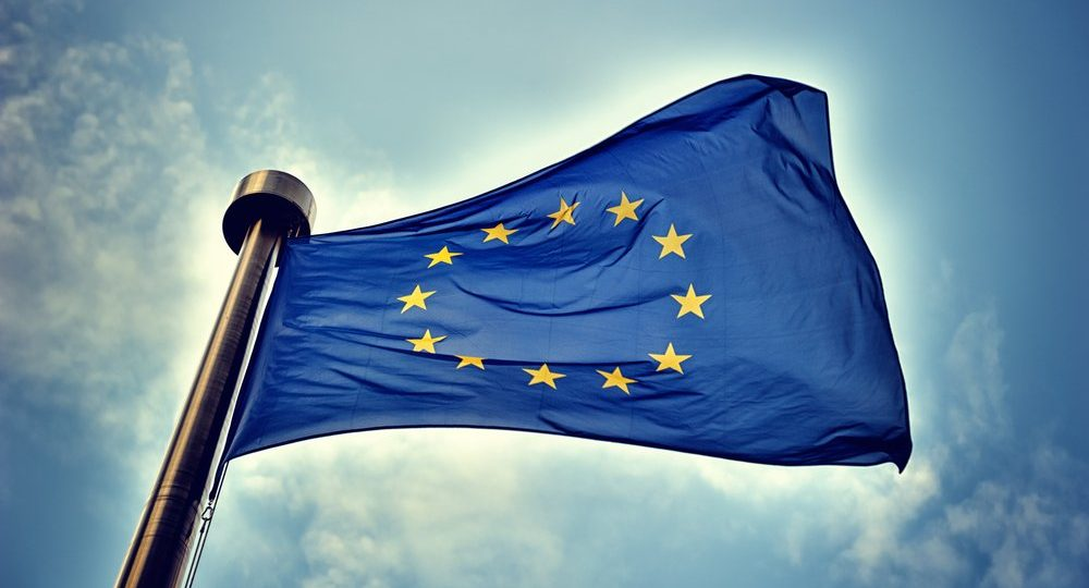 European Union flag against a blue sky background