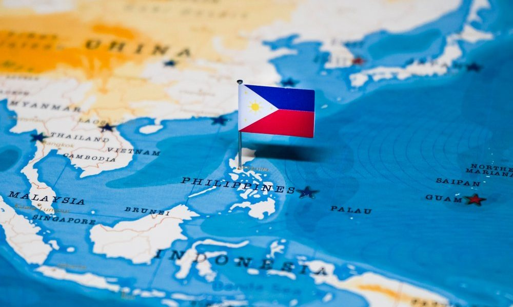 flag of the Philippines pinned on the country's map